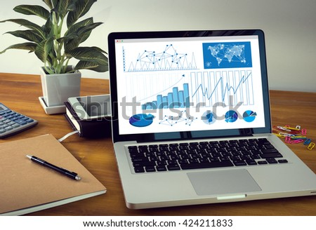 Business Research Data Economy Laptop on table. Warm tone - stock photo