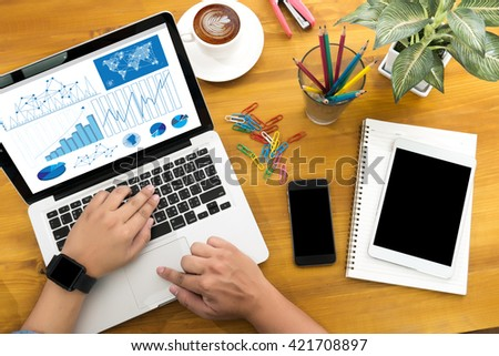 Business Research Data Economy Male person sitting front open laptop computer and smart phone content,modern businessman work, top view - stock photo