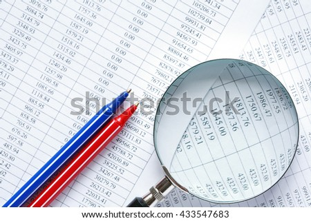 Business research. Magnifying glass and color pens on paper with digits - stock photo