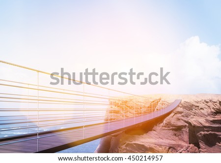 Business risk and success concept with bridge leading to cliff on sea and bright sky with sunlight background. Toned image. 3D Rendering - stock photo