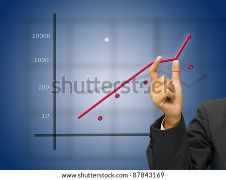 Business's hand adjust the graph - stock photo