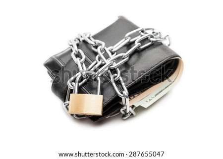 Business safety and finance protection concept - metal chain link with locked padlock on leather wallet full of dollar currency money white isolated - stock photo