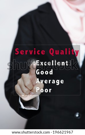 business, Service Quality concept - businesswomen pressing excellent virtual button on virtual screen - stock photo