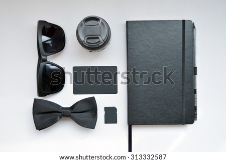Business set on white background with glasses, tie, business card, memory card and notebook - stock photo
