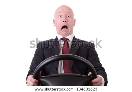 business shock isolated on white businessman with steering wheel - stock photo