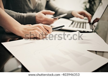 Business situation,team work, brainstorming.Photo account managers working modern office with new business project.Using laptop, discussion startup. Horizontal.Blurred,film effect - stock photo