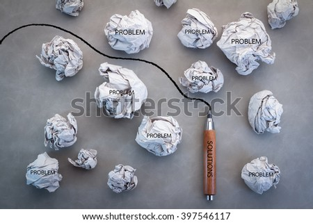 business solution concept with trash paper and pencil line on grey background - stock photo