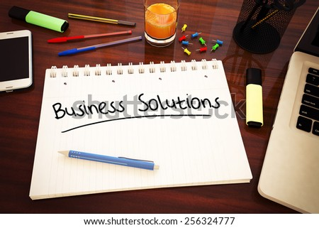 Business Solutions - handwritten text in a notebook on a desk - 3d render illustration. - stock photo
