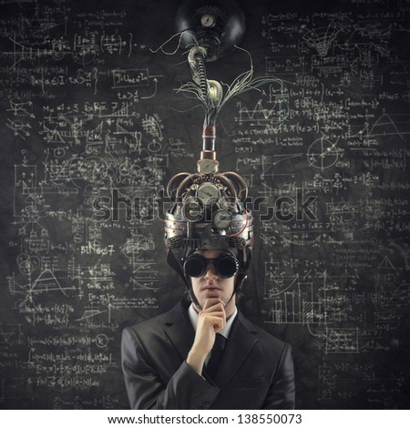 Business solutions: man wearing a brain-control helmet. - stock photo