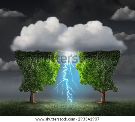 Business spark idea concept as two trees shaped as a head under a storm cloud creating a thunderbolt of lightning as a symbiotic success metaphor and creative collaboration unity. - stock photo