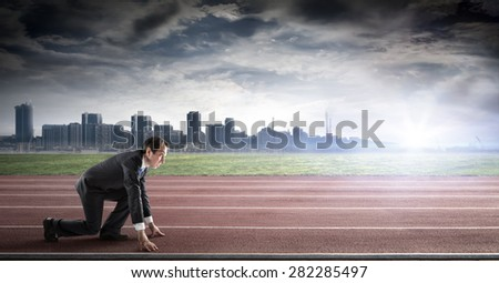 business start - businessman ready for competition - side view  - stock photo