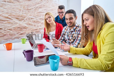 business, startup and people concept - happy creative team talking in modern office                            - stock photo