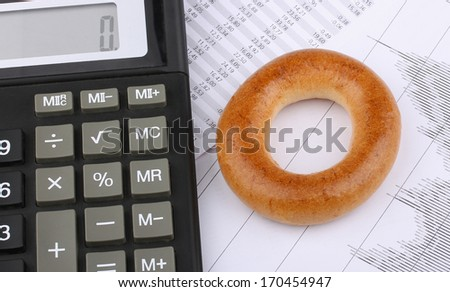 Business still-life of pen, charts, calculator, breakfast - stock photo