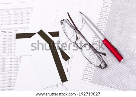 Business still-life of pen, charts, tables, eyeglasses, credit Cards - stock photo