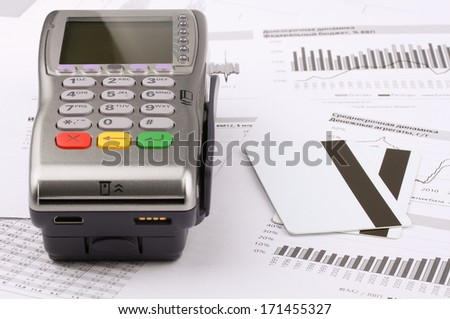 Business still-life of tables, payment terminal, credit Cards - stock photo