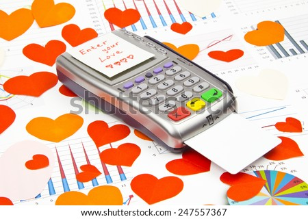 Business still-life of the payment terminal, credit cards, text message, many heart, LOVE-code - stock photo
