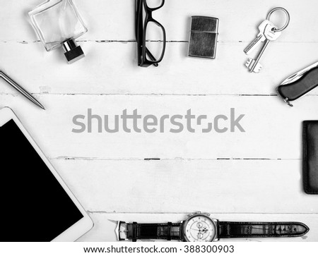 Business still-life with tablet and other accessories on the wooden table - stock photo