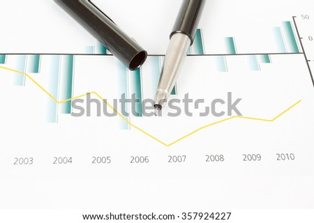 business stock market graphs with black pen - stock photo