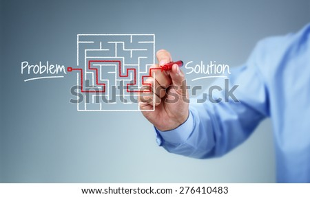 Business strategy businessman planning and finding a solution through a drawing of a labyrinth maze - stock photo