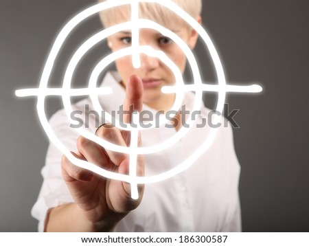 Business strategy concept with dartboard and woman - stock photo