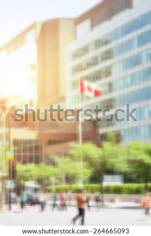 Business street view scene with Canadian flag, blurred and flare effects applied - stock photo