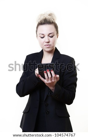 business style image of woman standing working our sums on a calculator - stock photo