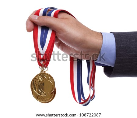 Business success businessman holding gold medals - stock photo