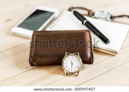 business successful man accessories, notepaper, pen, wristwatch, wallet, smart phone - stock photo