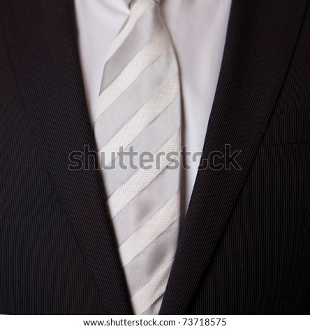 Business Suit with grey and white tie - stock photo