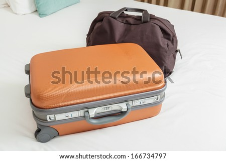 business suitcase on bed for traveling - stock photo