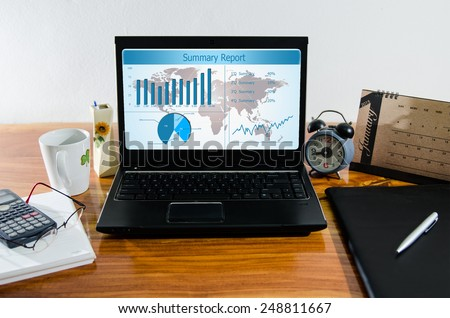 Business summary chart and planing in computer on desktop. - stock photo