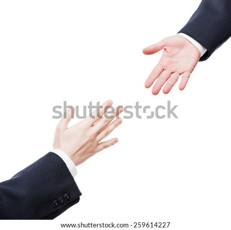 Business support and assistance concept - businessman giving helping hand to team partner white isolated - stock photo