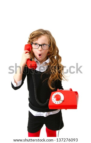 Business surprised little girl with a red phone on  white background - stock photo