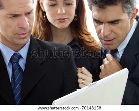 Business team anaiyzing a computer. - stock photo
