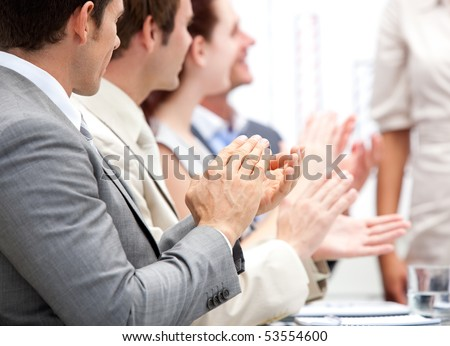 Business team applauding a presentation in the office - stock photo