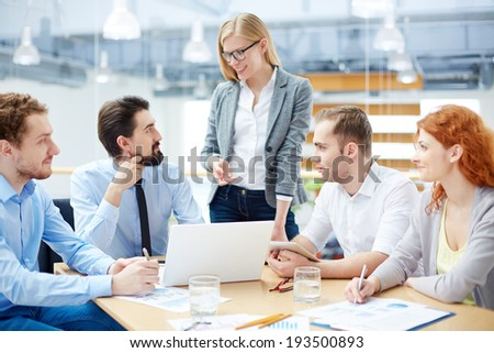 Business team approving his colleague�¢??s idea about company�¢??s development  - stock photo