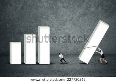 Business team are building profit chart by pulling and pushing the part of chart - stock photo