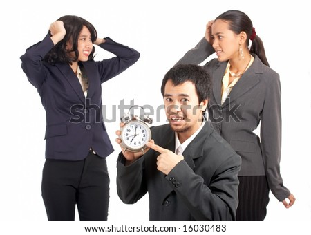 business team are stressed for the upcoming deadline - stock photo
