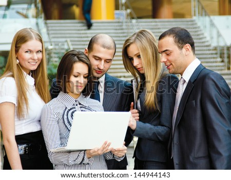 Business team at a meeting in a modern office environment - stock photo
