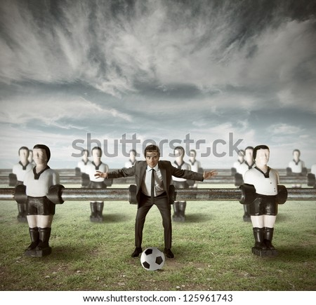Business team attack in a green field - stock photo