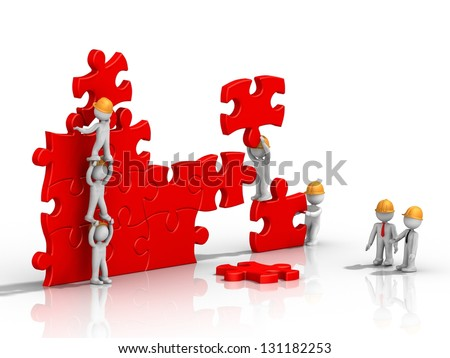 Business team building a puzzle - stock photo