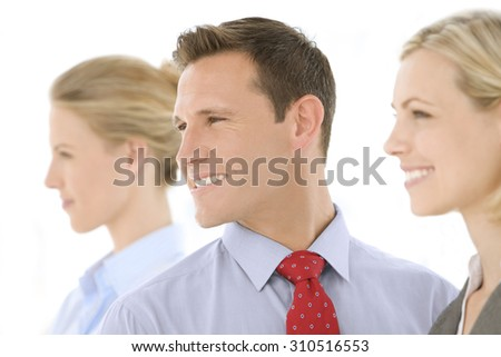 Business Team. Business people standing in a row. Selective focus on the man. Profile view. - stock photo