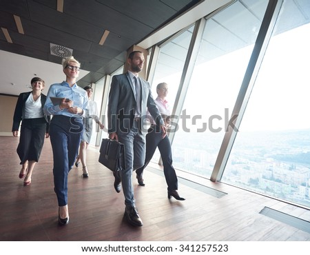 business team, businesspeople  group walking at modern bright office interior - stock photo
