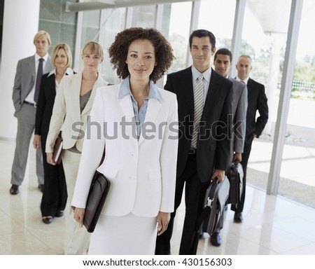 Business team concept - Business people in modern office lobby - stock photo