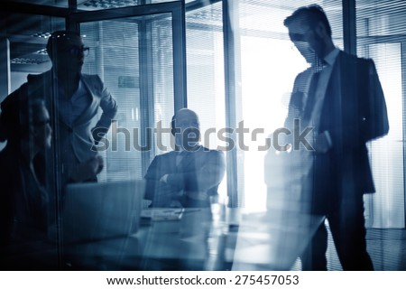 Business team consulting or planning work at meeting - stock photo