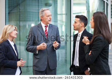 Business team discussing - stock photo