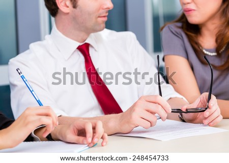 Business team discussing current issues in a meeting  - stock photo