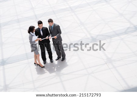 Business team discussing documents, view from above - stock photo