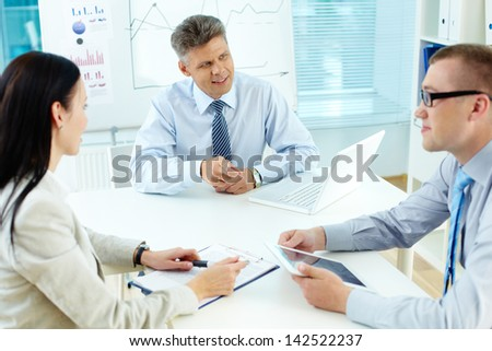 Business team discussing ideas at meeting in office - stock photo