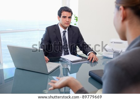 Business team during a meeting in an office - stock photo
